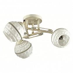 Потолочная люстра LumionНе более 4 ламп<br>Артикул - LMN_3119_3C,Бренд - Lumion (Италия),Коллекция - Tatina,Гарантия, месяцы - 24,Высота, мм - 210,Диаметр, мм - 450,Размер упаковки, мм - 120x330x460,Тип лампы - компактная люминесцентная [КЛЛ] ИЛИнакаливания ИЛИсветодиодная [LED],Общее кол-во ламп - 3,Напряжение питания лампы, В - 220,Максимальная мощность лампы, Вт - 40,Лампы в комплекте - отсутствуют,Цвет плафонов и подвесок - белый с рисунком, неокрашенный,Тип поверхности плафонов - матовый, прозрачный, рельефный,Материал плафонов и подвесок - стекло, хрусталь,Цвет арматуры - белый с золотой патиной,Тип поверхности арматуры - матовый,Материал арматуры - металл,Возможность подлючения диммера - можно, если установить лампу накаливания,Тип цоколя лампы - E14,Класс электробезопасности - I,Общая мощность, Вт - 120,Степень пылевлагозащиты, IP - 20,Диапазон рабочих температур - комнатная температура,Дополнительные параметры - способ крепления к потолку - на монтажной пластине, поворотный светильник<br>