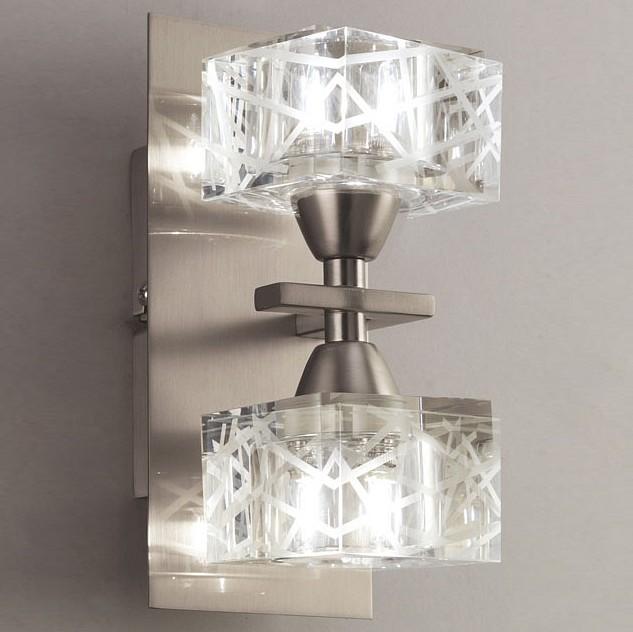 Бра MantraНастенные светильники<br>Артикул - MN_1445,Бренд - Mantra (Испания),Коллекция - Zen Satin Nickel,Гарантия, месяцы - 24,Время изготовления, дней - 1,Ширина, мм - 90,Высота, мм - 200,Выступ, мм - 113,Тип лампы - галогеновая,Общее кол-во ламп - 2,Напряжение питания лампы, В - 220,Максимальная мощность лампы, Вт - 40,Цвет лампы - белый теплый,Лампы в комплекте - галогеновые G9,Цвет плафонов и подвесок - неокрашенный,Тип поверхности плафонов - прозрачный, рельефный,Материал плафонов и подвесок - стекло,Цвет арматуры - никель,Тип поверхности арматуры - сатин,Материал арматуры - дюралюминий, сталь,Количество плафонов - 2,Возможность подлючения диммера - можно,Форма и тип колбы - пальчиковая,Тип цоколя лампы - G9,Цветовая температура, K - 2800 - 3200 K,Экономичнее лампы накаливания - на 50%,Класс электробезопасности - I,Общая мощность, Вт - 80,Степень пылевлагозащиты, IP - 20,Диапазон рабочих температур - комнатная температура,Дополнительные параметры - светильник предназначен для использования со скрытой проводкой<br>