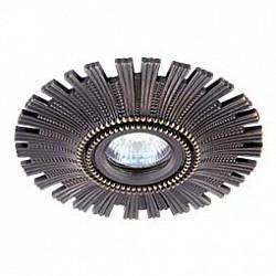 Встраиваемый светильник NovotechСветильники для натяжных потолков<br>Артикул - NV_369972,Бренд - Novotech (Венгрия),Коллекция - Vintage,Гарантия, месяцы - 24,Диаметр, мм - 150,Тип лампы - галогеновая ИЛИсветодиодная [LED],Общее кол-во ламп - 1,Напряжение питания лампы, В - 12,Максимальная мощность лампы, Вт - 50,Лампы в комплекте - отсутствуют,Цвет арматуры - темная бронза,Тип поверхности арматуры - глянцевый, рельефный,Материал арматуры - алюминий,Форма и тип колбы - полусферическая с рефлектором,Тип цоколя лампы - GX5.3,Класс электробезопасности - III,Степень пылевлагозащиты, IP - 20,Диапазон рабочих температур - комнатная температура,Дополнительные параметры - алюминиевое литье<br>
