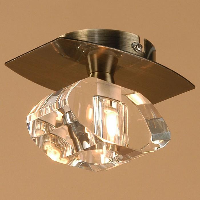 Светильник на штанге MantraТочечные светильники<br>Артикул - MN_0560,Бренд - Mantra (Испания),Коллекция - Alfa,Гарантия, месяцы - 24,Время изготовления, дней - 1,Выступ, мм - 100,Диаметр, мм - 140,Тип лампы - галогеновая,Общее кол-во ламп - 1,Напряжение питания лампы, В - 220,Максимальная мощность лампы, Вт - 40,Цвет лампы - белый теплый,Лампы в комплекте - галогеновая G9,Цвет плафонов и подвесок - неокрашенный,Тип поверхности плафонов - прозрачный,Материал плафонов и подвесок - стекло,Цвет арматуры - латунь античная,Тип поверхности арматуры - сатин,Материал арматуры - металл,Количество плафонов - 1,Возможность подлючения диммера - можно,Форма и тип колбы - пальчиковая,Тип цоколя лампы - G9,Цветовая температура, K - 2800 - 3200 K,Экономичнее лампы накаливания - на 50%,Класс электробезопасности - I,Степень пылевлагозащиты, IP - 20,Диапазон рабочих температур - комнатная температура<br>