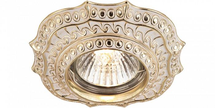 Встраиваемый светильник NovotechКвадратные<br>Артикул - NV_369856,Бренд - Novotech (Венгрия),Коллекция - Vintage,Гарантия, месяцы - 24,Время изготовления, дней - 1,Длина, мм - 106,Ширина, мм - 106,Выступ, мм - 19,Глубина, мм - 17,Размер врезного отверстия, мм - 70,Тип лампы - галогеновая ИЛИсветодиодная [LED],Общее кол-во ламп - 1,Напряжение питания лампы, В - 12,Максимальная мощность лампы, Вт - 50,Цвет лампы - белый теплый,Лампы в комплекте - отсутствуют,Цвет арматуры - белый, золотой,Тип поверхности арматуры - матовый,Материал арматуры - латунь,Количество плафонов - 1,Возможность подлючения диммера - можно, если установить галогеновую лампу и подключить трансформатор 12 В с возможностью диммирования,Необходимые компоненты - трансформатор 12 В,Компоненты, входящие в комплект - нет,Форма и тип колбы - полусферическая с рефлектором,Тип цоколя лампы - GX5.3,Цветовая температура, K - 2800 - 3200 K,Экономичнее лампы накаливания - на 50%,Класс электробезопасности - III,Напряжение питания, В - 220,Общая мощность, Вт - 50,Степень пылевлагозащиты, IP - 20,Диапазон рабочих температур - комнатная температура,Дополнительные параметры - электролизное медное покрытие арматуры<br>