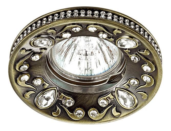 Встраиваемый светильник NovotechХрустальные<br>Артикул - NV_370235,Бренд - Novotech (Венгрия),Коллекция - Erba,Гарантия, месяцы - 24,Высота, мм - 27,Выступ, мм - 12,Глубина, мм - 15,Диаметр, мм - 96,Размер врезного отверстия, мм - 75,Размер упаковки, мм - 45х100х100,Тип лампы - компактная люминесцентная [КЛЛ]ИЛИнакаливания ИЛИсветодиодная [LED],Общее кол-во ламп - 1,Напряжение питания лампы, В - 12,Максимальная мощность лампы, Вт - 50,Лампы в комплекте - отсутствуют,Цвет арматуры - бронза, коричневый, неокрашенный,Тип поверхности арматуры - матовый, прозрачный, рельефный,Материал арматуры - сплав цинка, хрусталь,Возможность подлючения диммера - можно, если установить галогеновую лампу и подключить трансформатор 12 В с возможностью диммирования,Необходимые компоненты - блок питания 12 В,Компоненты, входящие в комплект - нет,Форма и тип колбы - полусферическая с рефлектором,Тип цоколя лампы - GX5.3,Класс электробезопасности - III,Напряжение питания, В - 220,Степень пылевлагозащиты, IP - 20,Диапазон рабочих температур - комнатная температура<br>