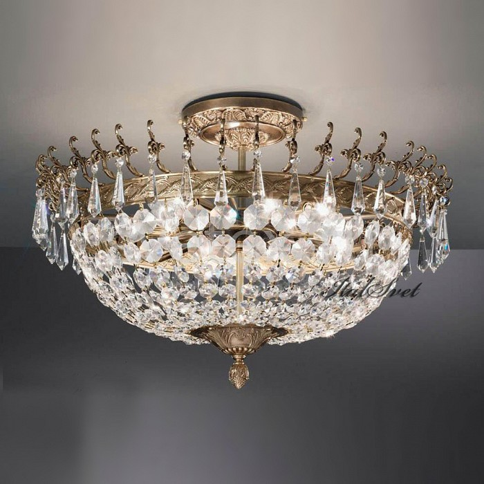 Люстра на штанге NervilampБолее 6 ламп<br>Артикул - NL_880_6-3PL_Gold_Bronze,Бренд - Nervilamp (Италия),Коллекция - 880,Гарантия, месяцы - 24,Высота, мм - 420,Диаметр, мм - 580,Тип лампы - компактная люминесцентная [КЛЛ] ИЛИнакаливания ИЛИсветодиодная [LED],Общее кол-во ламп - 9,Напряжение питания лампы, В - 220,Максимальная мощность лампы, Вт - 60,Лампы в комплекте - отсутствуют,Цвет плафонов и подвесок - неокрашенный,Тип поверхности плафонов - прозрачный,Материал плафонов и подвесок - хрусталь,Цвет арматуры - бронза с золотом,Тип поверхности арматуры - матовый, металлик, рельефный,Материал арматуры - металл,Возможность подлючения диммера - можно, если установить лампу накаливания,Тип цоколя лампы - E14,Класс электробезопасности - I,Общая мощность, Вт - 540,Степень пылевлагозащиты, IP - 20,Диапазон рабочих температур - комнатная температура,Дополнительные параметры - способ крепления светильника к потолку - на монтажной пластине<br>
