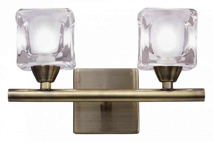 Бра MantraНастенные светильники<br>Артикул - MN_0993,Бренд - Mantra (Испания),Коллекция - Cuadrax,Гарантия, месяцы - 24,Время изготовления, дней - 1,Ширина, мм - 200,Высота, мм - 150,Выступ, мм - 150,Тип лампы - галогеновая,Общее кол-во ламп - 2,Напряжение питания лампы, В - 220,Максимальная мощность лампы, Вт - 40,Цвет лампы - белый теплый,Лампы в комплекте - галогеновые G9,Цвет плафонов и подвесок - неокрашенный,Тип поверхности плафонов - матовый,Материал плафонов и подвесок - стекло,Цвет арматуры - латунь античная,Тип поверхности арматуры - матовый,Материал арматуры - металл,Количество плафонов - 2,Возможность подлючения диммера - можно,Форма и тип колбы - пальчиковая,Тип цоколя лампы - G9,Цветовая температура, K - 2800 - 3200 K,Экономичнее лампы накаливания - на 50%,Класс электробезопасности - I,Общая мощность, Вт - 80,Степень пылевлагозащиты, IP - 20,Диапазон рабочих температур - комнатная температура,Дополнительные параметры - светильник предназначен для использования со скрытой проводкой<br>