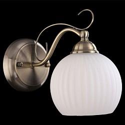 Бра EurosvetКруглые<br>Артикул - EV_7349,Бренд - Eurosvet (Китай),Коллекция - 7704,Гарантия, месяцы - 24,Высота, мм - 260,Диаметр, мм - 200,Тип лампы - компактная люминесцентная [КЛЛ] ИЛИнакаливания ИЛИсветодиодная [LED],Общее кол-во ламп - 1,Напряжение питания лампы, В - 220,Максимальная мощность лампы, Вт - 60,Лампы в комплекте - отсутствуют,Цвет плафонов и подвесок - белый,Тип поверхности плафонов - матовый, рельефный,Материал плафонов и подвесок - стекло,Цвет арматуры - бронза античная,Тип поверхности арматуры - глянцевый,Материал арматуры - металл,Тип цоколя лампы - E27,Класс электробезопасности - I,Степень пылевлагозащиты, IP - 20,Диапазон рабочих температур - комнатная температура,Дополнительные параметры - светильник предназначен для использования со скрытой проводкой<br>