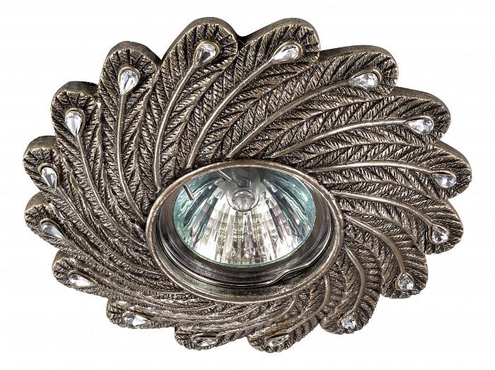Встраиваемый светильник NovotechВстраиваемые светильники<br>Артикул - NV_370108,Бренд - Novotech (Венгрия),Коллекция - Pattern,Гарантия, месяцы - 24,Время изготовления, дней - 1,Глубина, мм - 17,Диаметр, мм - 135,Размер врезного отверстия, мм - 65,Тип лампы - галогеновая ИЛИсветодиодная [LED],Общее кол-во ламп - 1,Напряжение питания лампы, В - 12,Максимальная мощность лампы, Вт - 50,Лампы в комплекте - отсутствуют,Цвет арматуры - бронза,Тип поверхности арматуры - глянцевый, рельефный,Материал арматуры - камень песчаник,Необходимые компоненты - трансформатор 12В,Компоненты, входящие в комплект - нет,Форма и тип колбы - полусферическая с рефлектором,Тип цоколя лампы - GX5.3,Класс электробезопасности - III,Напряжение питания, В - 220,Степень пылевлагозащиты, IP - 20,Диапазон рабочих температур - комнатная температура<br>