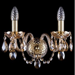 Бра Bohemia Ivele CrystalБолее 1 лампы<br>Артикул - BI_1400_2_G_M721,Бренд - Bohemia Ivele Crystal (Чехия),Коллекция - 1400,Гарантия, месяцы - 24,Высота, мм - 210,Размер упаковки, мм - 250x180x170,Тип лампы - компактная люминесцентная [КЛЛ] ИЛИнакаливания ИЛИсветодиодная [LED],Общее кол-во ламп - 2,Напряжение питания лампы, В - 220,Максимальная мощность лампы, Вт - 40,Лампы в комплекте - отсутствуют,Цвет плафонов и подвесок - коньячный,Тип поверхности плафонов - прозрачный,Материал плафонов и подвесок - хрусталь,Цвет арматуры - золото, коньячный,Тип поверхности арматуры - глянцевый, прозрачный, рельефный,Материал арматуры - металл, стекло,Возможность подлючения диммера - можно, если установить лампу накаливания,Форма и тип колбы - свеча ИЛИ свеча на ветру,Тип цоколя лампы - E14,Класс электробезопасности - I,Общая мощность, Вт - 80,Степень пылевлагозащиты, IP - 20,Диапазон рабочих температур - комнатная температура,Дополнительные параметры - способ крепления светильника на стене – на монтажной пластине, светильник предназначен для использования со скрытой проводкой<br>
