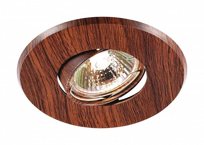 Встраиваемый светильник NovotechКруглые<br>Артикул - NV_369710,Бренд - Novotech (Венгрия),Коллекция - Wood,Гарантия, месяцы - 24,Время изготовления, дней - 1,Глубина, мм - 20,Диаметр, мм - 110,Размер врезного отверстия, мм - 85,Тип лампы - галогеновая ИЛИсветодиодная [LED],Общее кол-во ламп - 1,Напряжение питания лампы, В - 12,Максимальная мощность лампы, Вт - 50,Лампы в комплекте - отсутствуют,Цвет плафонов и подвесок - красное дерево,Тип поверхности плафонов - глянцевый,Материал плафонов и подвесок - алюминиевое литье,Цвет арматуры - красное дерево,Тип поверхности арматуры - глянцевый,Материал арматуры - алюминиевое литье,Количество плафонов - 1,Возможность подлючения диммера - можно, если установить галогеновую лампу,Форма и тип колбы - полусферическая с рефлектором ИЛИполусферическая с радиатором,Тип цоколя лампы - GX5.3,Экономичнее лампы накаливания - на 50%,Класс электробезопасности - I,Напряжение питания, В - 220,Степень пылевлагозащиты, IP - 20,Диапазон рабочих температур - комнатная температура,Дополнительные параметры - поворотный светильник, угол поворота 45?, возможна установка лампы GX5.3 на 12 В вместе с трансформатором на 12 В<br>