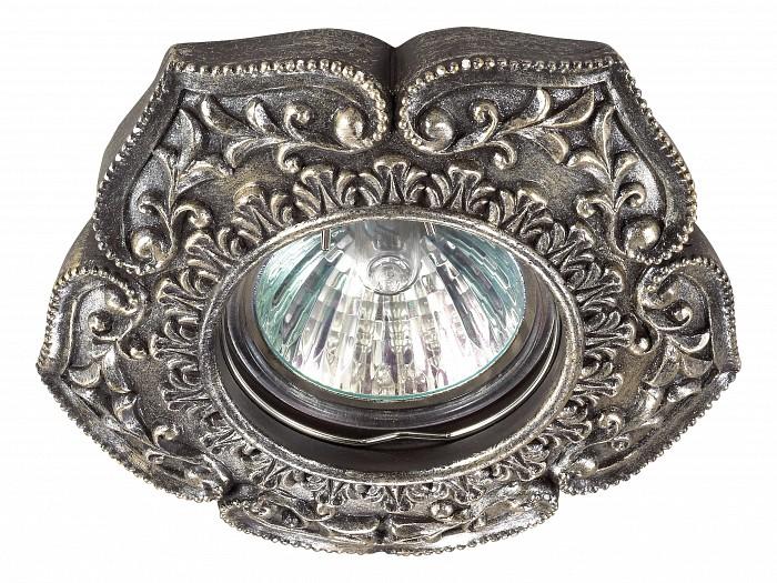 Встраиваемый светильник NovotechВстраиваемые светильники<br>Артикул - NV_370082,Бренд - Novotech (Венгрия),Коллекция - Pattern,Гарантия, месяцы - 24,Время изготовления, дней - 1,Глубина, мм - 17,Диаметр, мм - 110,Размер врезного отверстия, мм - 65,Тип лампы - галогеновая ИЛИсветодиодная [LED],Общее кол-во ламп - 1,Напряжение питания лампы, В - 12,Максимальная мощность лампы, Вт - 50,Лампы в комплекте - отсутствуют,Цвет арматуры - бронза,Тип поверхности арматуры - глянцевый, рельефный,Материал арматуры - камень песчаник,Необходимые компоненты - трансформатор 12В,Компоненты, входящие в комплект - нет,Форма и тип колбы - полусферическая с рефлектором,Тип цоколя лампы - GX5.3,Класс электробезопасности - III,Напряжение питания, В - 220,Степень пылевлагозащиты, IP - 20,Диапазон рабочих температур - комнатная температура<br>