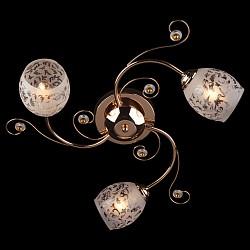 Потолочная люстра ОптимаНе более 4 ламп<br>Артикул - EV_6840,Бренд - Оптима (Китай),Коллекция - 9677,Гарантия, месяцы - 24,Высота, мм - 220,Диаметр, мм - 550,Тип лампы - компактная люминесцентная [КЛЛ] ИЛИнакаливания ИЛИсветодиодная [LED],Общее кол-во ламп - 3,Напряжение питания лампы, В - 220,Максимальная мощность лампы, Вт - 60,Лампы в комплекте - отсутствуют,Цвет плафонов и подвесок - белый с рисунком, золото, неокрашенный,Тип поверхности плафонов - матовый,Материал плафонов и подвесок - металл, стекло,Цвет арматуры - золото,Тип поверхности арматуры - глянцевый,Материал арматуры - металл,Тип цоколя лампы - E27,Класс электробезопасности - I,Общая мощность, Вт - 180,Степень пылевлагозащиты, IP - 20,Диапазон рабочих температур - комнатная температура<br>